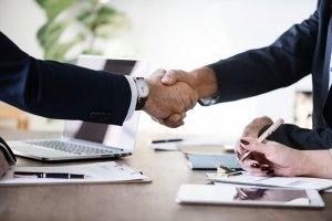 Business men engaged in a handshake